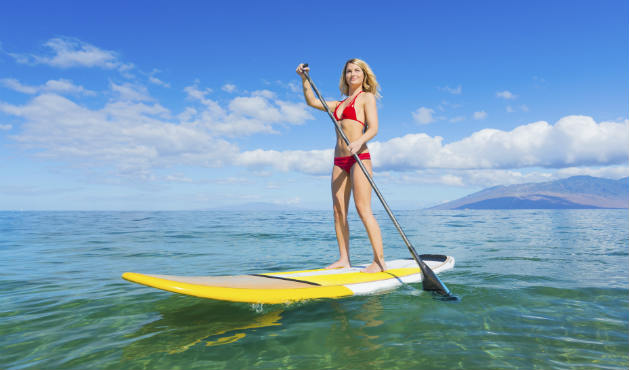Stand up paddle melhora a postura - Foto: Getty Images